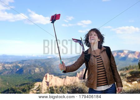 Young Tourist Taking A Photo Of Herself In Bryce Canyon National Park