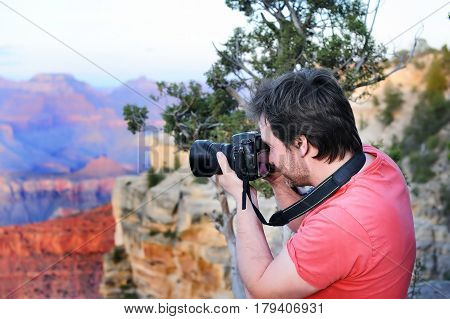 Male Tourist Making Photo Of The Grand Canyon