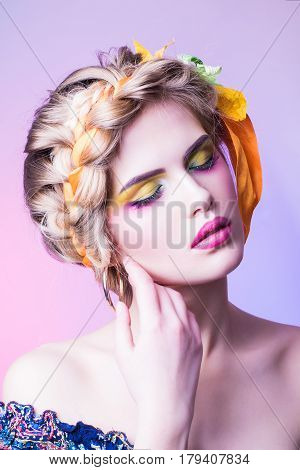 Beauty girl portrait with colorful makeup, hair, nail polish and accessories. Colourful studio shot of funny woman.