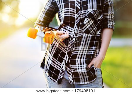 Hipster Girl With Skateboard Outdoors