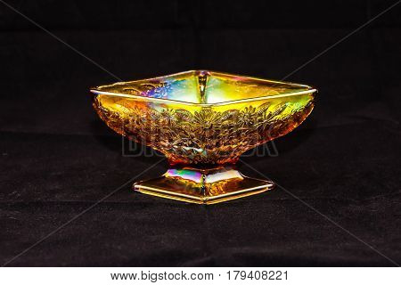 golden dish (three inches high, six inches wide)