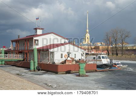 ST PETERSBURG, RUSSIA - MARCH 20, 2017: The landing stage of the rescue station of the Ministry of Emergencies of Russia against the background of the Peter and Paul fortress in March day