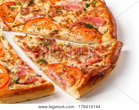 Close up view on piece of pizza with ham. Isolated on white with clipping path