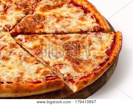 Close up view on piece of pizza with 4 sorts of cheese on wooden cutting board. Isolated on white with clipping path
