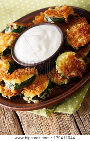 Homemade Zucchini Slices In Breadcrumbs With Sour Cream Close-up. Vertical