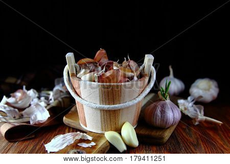 the garlic cloves in a wooden tub with a sprouted garlic