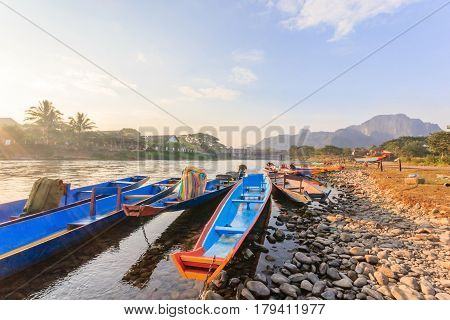 long tail boats in Song river at Vang Vieng Laos.