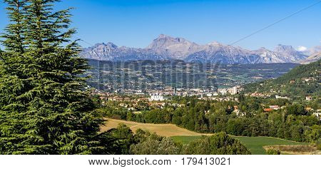 The Hautes Alpes city of Gap in Summer. Panoramic. Southern French Alps France