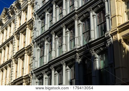 Painted 19th century facades in Manhattan's Soho neighborhood with cast iron columns and ornamentation. New York City