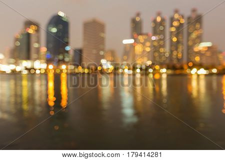 Reflection blurred light office building night view abstract background
