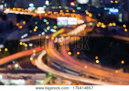 Blurred bokeh lights aerial view highway interchanged night view abstract background