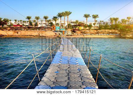 Pontoon through coral reef to the sea