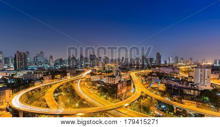 Twilight highway overpass curved with city office building downtown blue twilight sky background