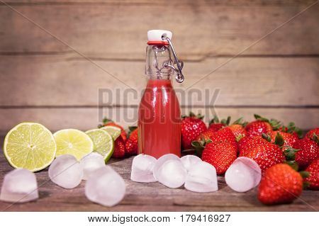 Fresh Smoothie Or Juice Of Strawberries, Lime And Icecubes