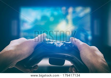 gaming game play tv fun gamer gamepad guy controller video console playing player holding hobby playful enjoyment view concept