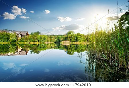 Village by the calm river in spring