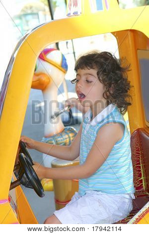 little gird playing driving toy car outdoor