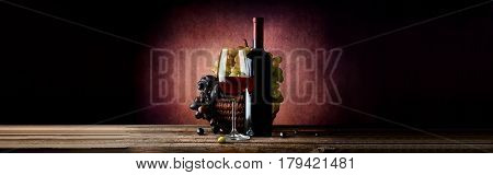 Wine with grape in basket on a vinous background