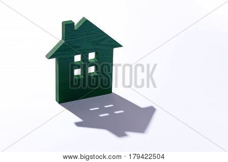 Wooden house modelling on white background. Wooden House Shaped. Model of the house on white background
