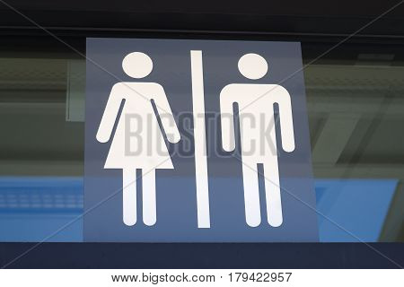 toilet wc restroom sign men and woman icon graphic on window
