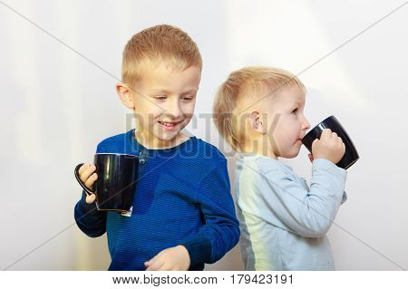 Two Boys Kids Drinking Drink From Mugs
