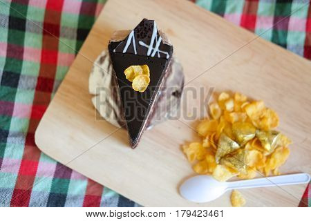 Sweet brownie chocolate cream cake topped with corn flakes