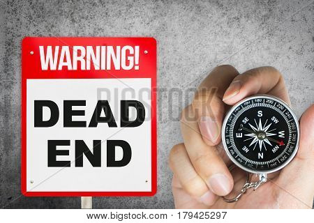 Compass leading to wrong way dead end concept.