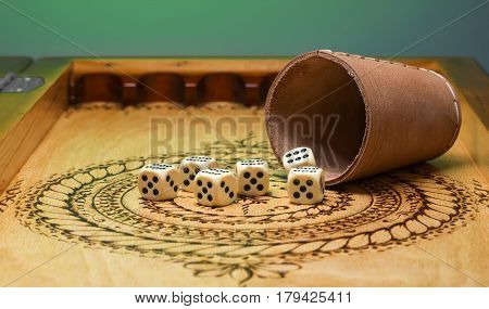 image of elements of gambling on a carved wooden board