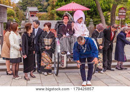 KAMAKURA JAPAN - APRIL 14 2014: Japanese wedding ceremony at Tsurugaoka Hachimangu shrine on April 14 2014 in Kamakura Japan. One the most important Shinto shrine in Kamakura