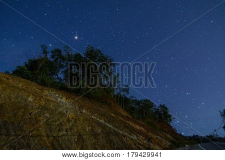 Hunting for the Milky Way with million of stars on the top  of the head located at Telipok Hill, Kota Kinabalu, Sabah, Malaysia