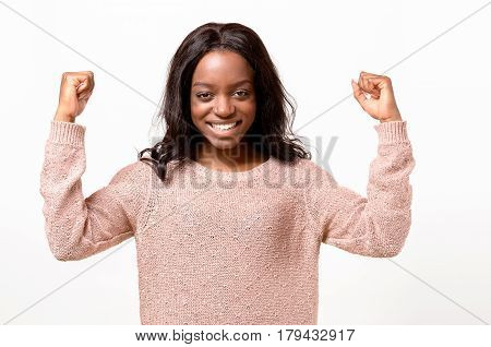 Exuberant Young African Woman Cheering