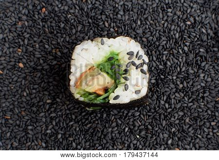 Sushi Roll With Smoked Eel And Seaweed Nori On Dark Background