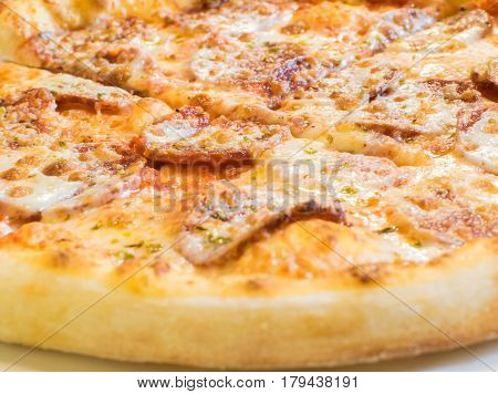 Fresh Hot Pizza With Pepperoni Sausage And Mozzarella Cheese Sprinkled With Herbs