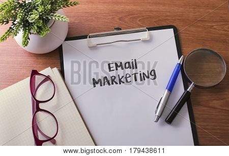 Email Marketing Word On Paper With Glass Ballpen And Green Plant.