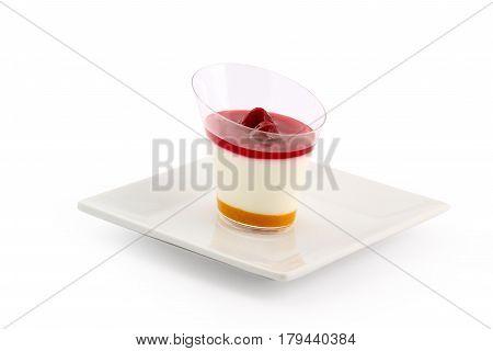 Cherry peach panna cotta on white plate II.
