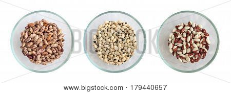 Dry White And Pinto Beans In Glass Round Bowls Isolated