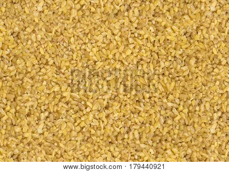 Dry Bulgur Wheat Background Closeup And Top View