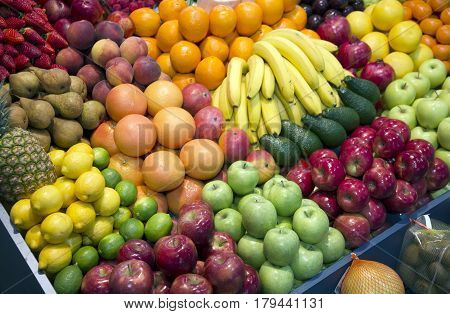 Ripe variety of fruits put on sale in the market. Set of freshly picked organic fruits at market stall. Freshly harvested collection of organic fruits as background