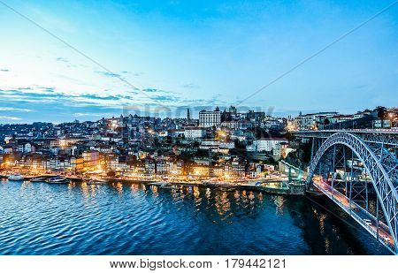 OPORTO PORTUGAL - OCTOBER 24 2016: Panorama of Oporto with famous Dom Luis I bridge - Top view of famous river Portugal city - Main focus in the middle of the frame