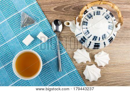 Tea In Bowl, Teapot, Meringue, Lumpy Sugar And Tea Bag