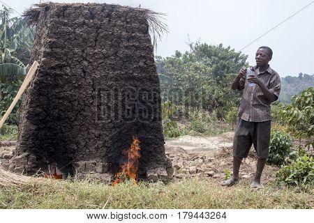Villager Making Bricks In Kiln, Uganda, Africa