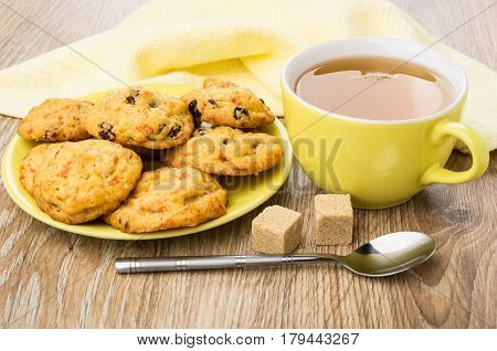 Tea, Shortbreads With Carrot And Raisin On Saucer, Lumpy Sugar