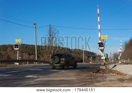 Railway crossing in the Czech Republic. Road crossing over the tracks. The inscription