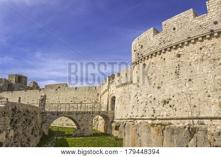 View of the Monte Sant'Angelo Castle.It is an architecture in the Apulian city of Monte Sant'Angelo, Italy (Apulia).The portal is preceded by a bridge with two arches placed across the moat.