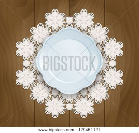 Beautiful dish on a lace napkin on a wooden background. Top view.