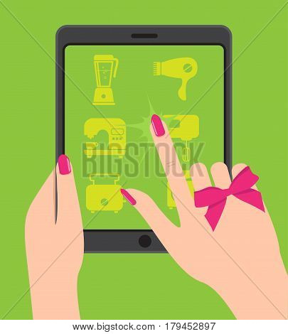 Hand holing smartphone, touching screen. Female hand holds tablet. Woman chooses goods in online store