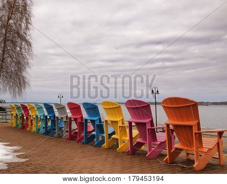 Adirondack chairs on the shore of The Saint Lawrence River facing The Thousand Islands in Clayton New York