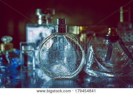 perfumery. Set of Different bottles of female perfum e