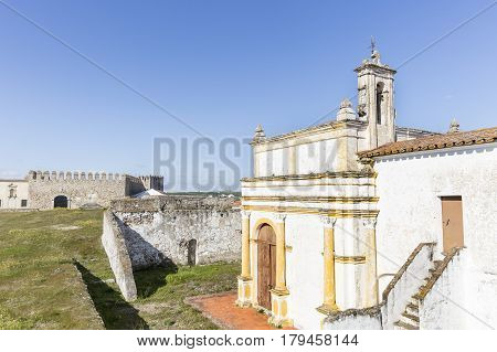 Senhor dos Aflitos church and the Castle inside the Medieval wall in Campo Maior city, Portalegre district, Portugal