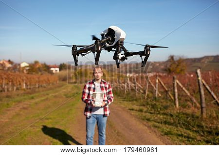 Drone hovering over ground and filming vineyard
